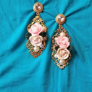 Gold tone earrings with pink and white resin roses